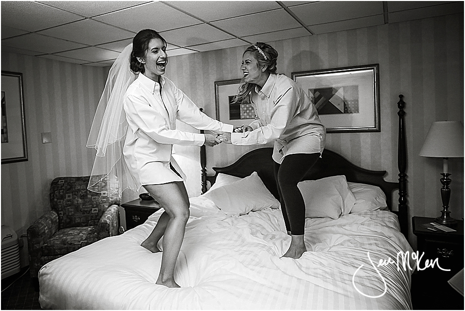 bride jumping on bed