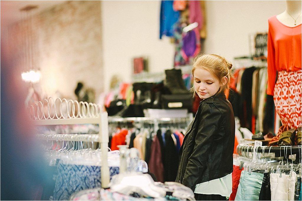 teen model inside of trendy trade wearing a leather jacket