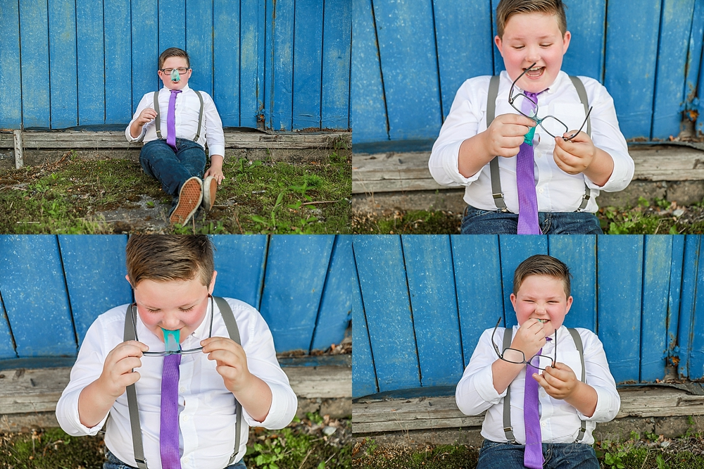 tween pops a bubble in front of a blue wall wearing purple suspenders in indiana county pa