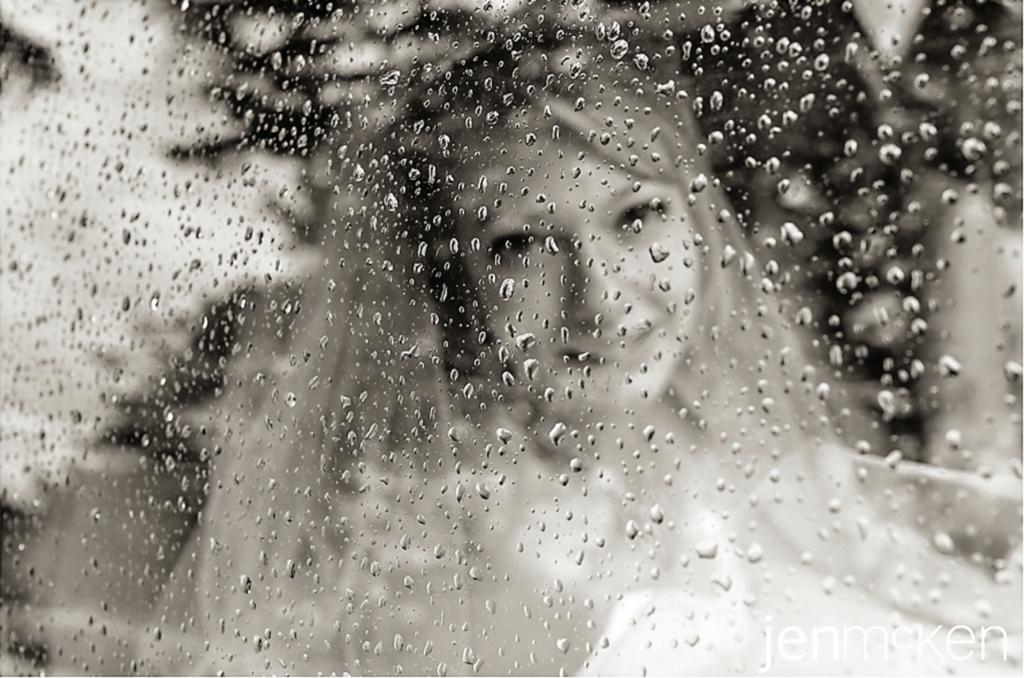 rainy day wedding with rain drops on the window