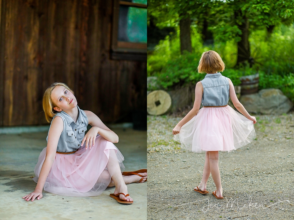 pre teen wearing a demin shirt and tulle skirt dancing around a barn