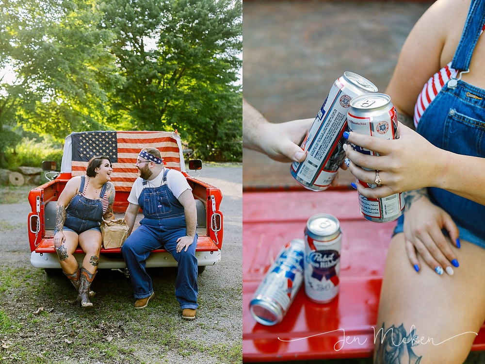 engaged couple sitting on the bed of a 1965 red chevy pickup wearing suspenders and drinking a PBR beer out of a paper bag