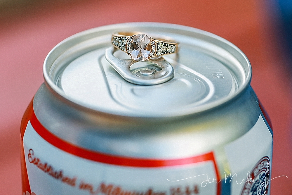 engagement ring on top of a pabst blue ribbon PBR beer can