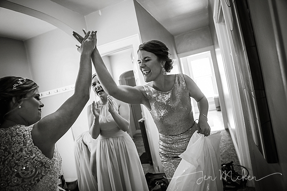 bride celebrates with her bridemaid