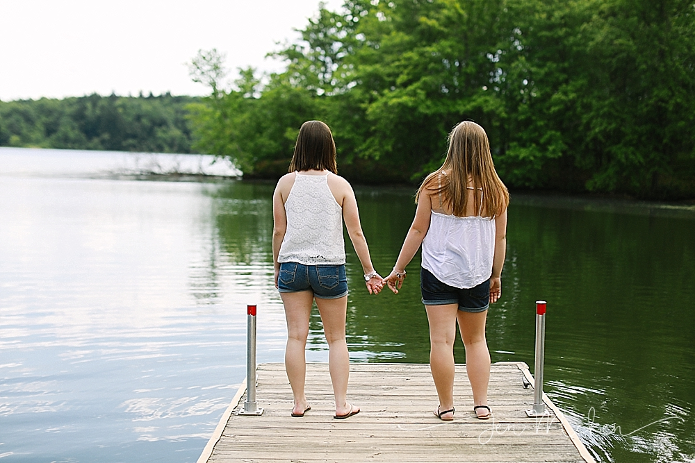 standing on a dock holding hands