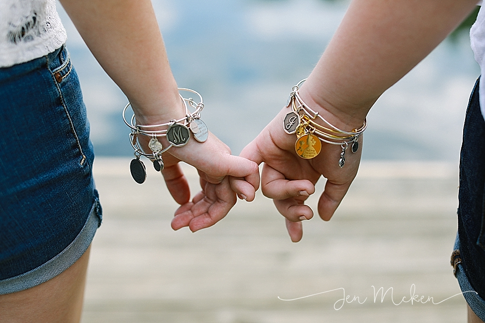 best friends wearing bracelets while standing on the dock at yellow creek state park