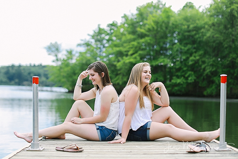 best friends laughing on a dock at yellow creek state park