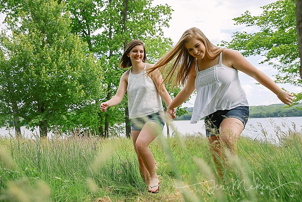 girls skipping thru a field at yellow creek state park in indiana pa