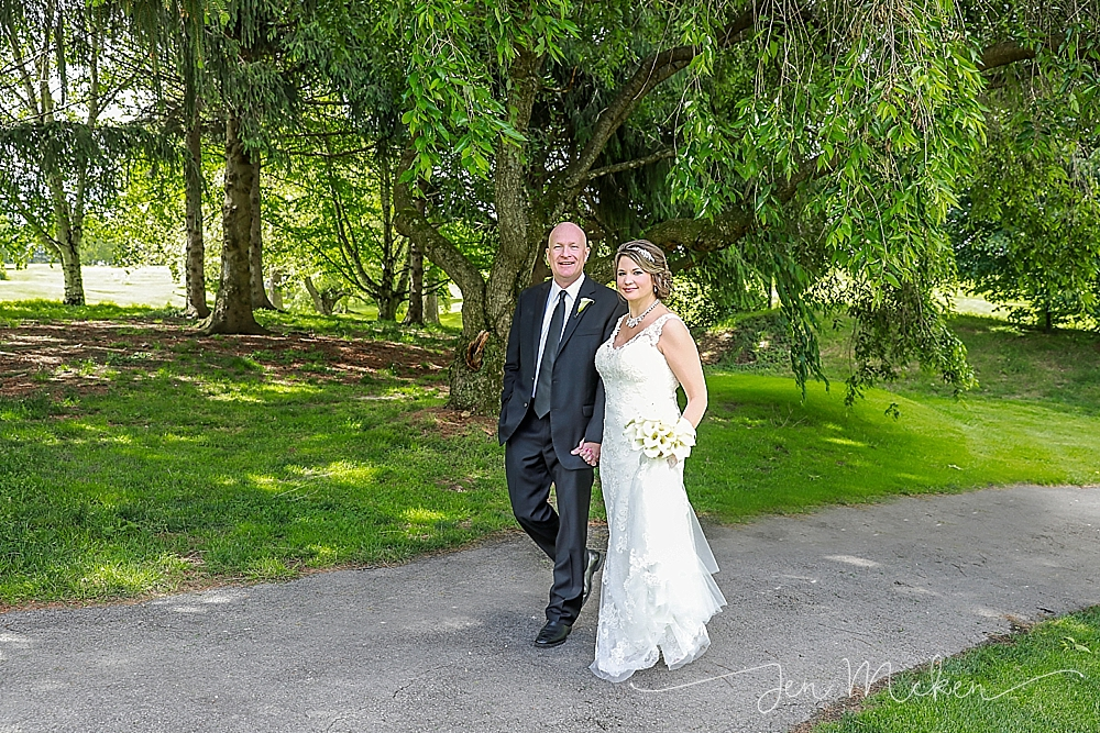 bride and groom walking down the path at the country club in indiana county pa