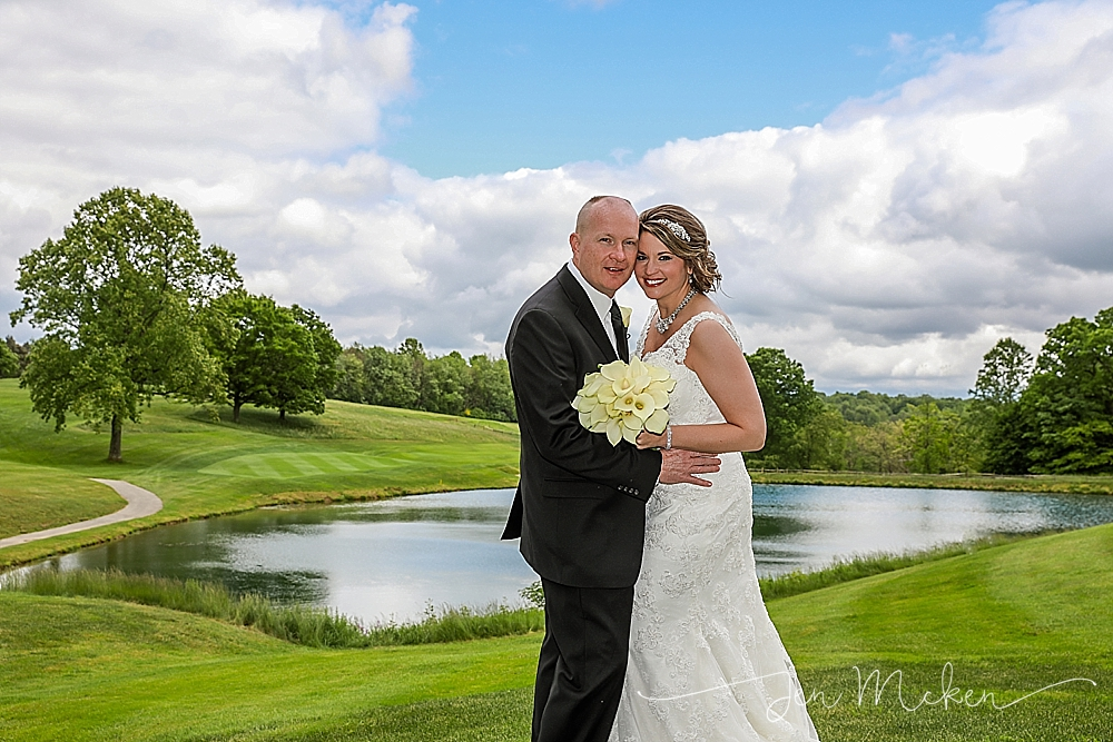 Bride and Groom smiling on a sunny summer day on the golf course and lake at the indiana county country club