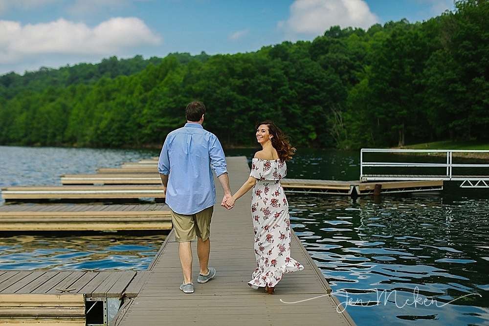 enageged couple walking along the dock at twolick lake in indiana pa