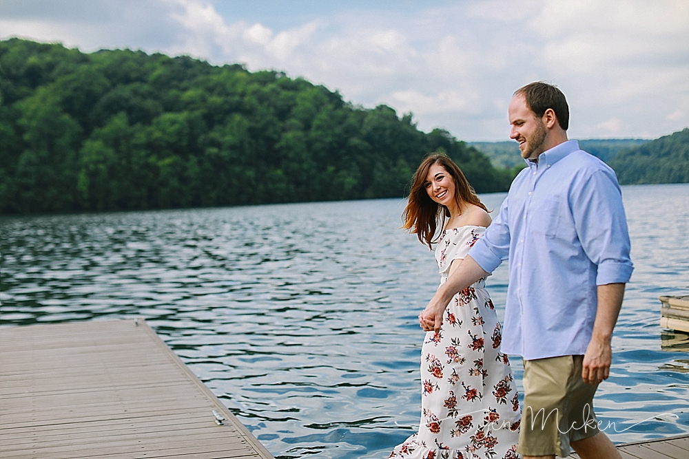 engaged couple walking along the dock at twolick park in indiana pa