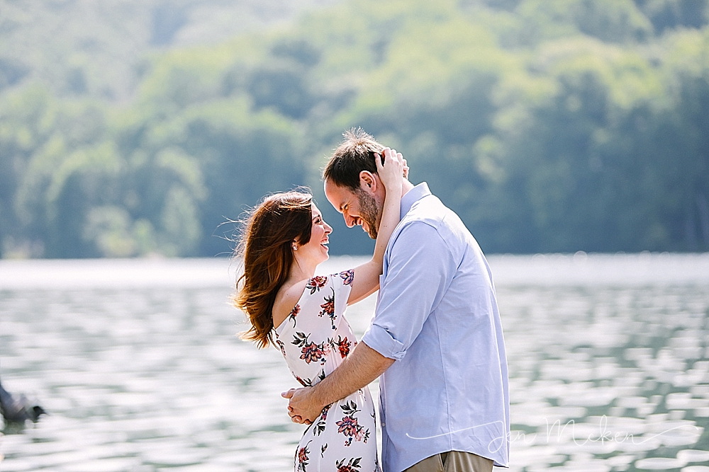 twolick enagement session of couple standing on a dock in indiana pa