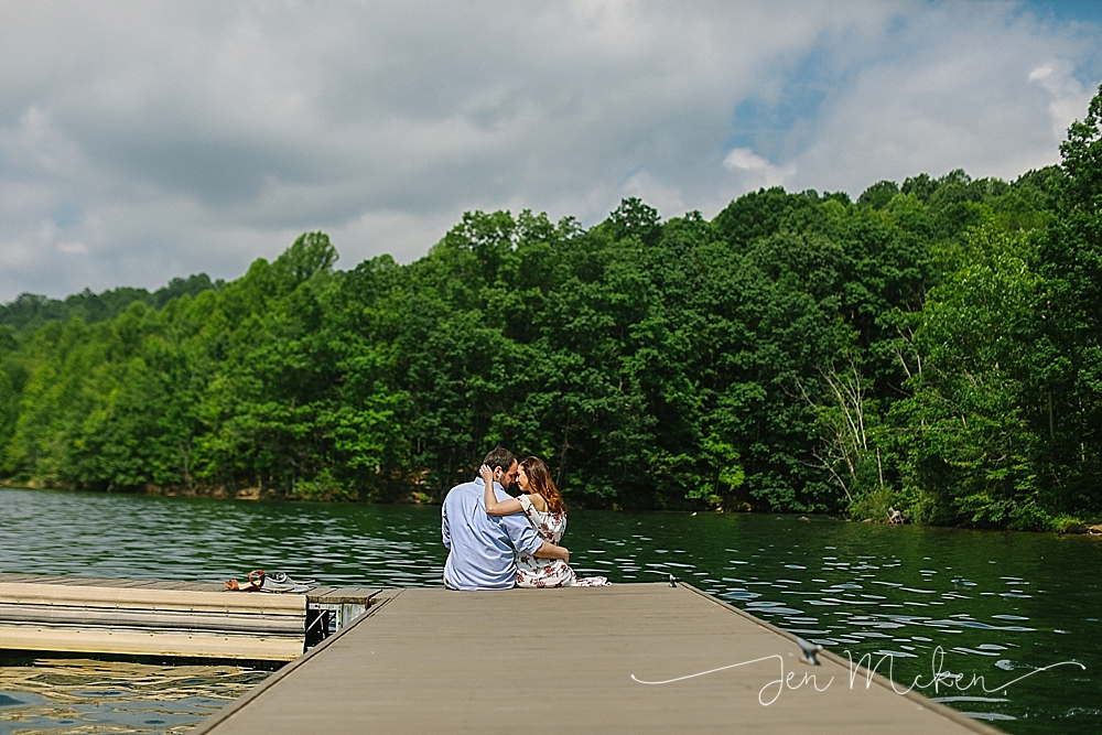 A sunny engagement session at twolick lake in indiana pa with couple sitting on the dock