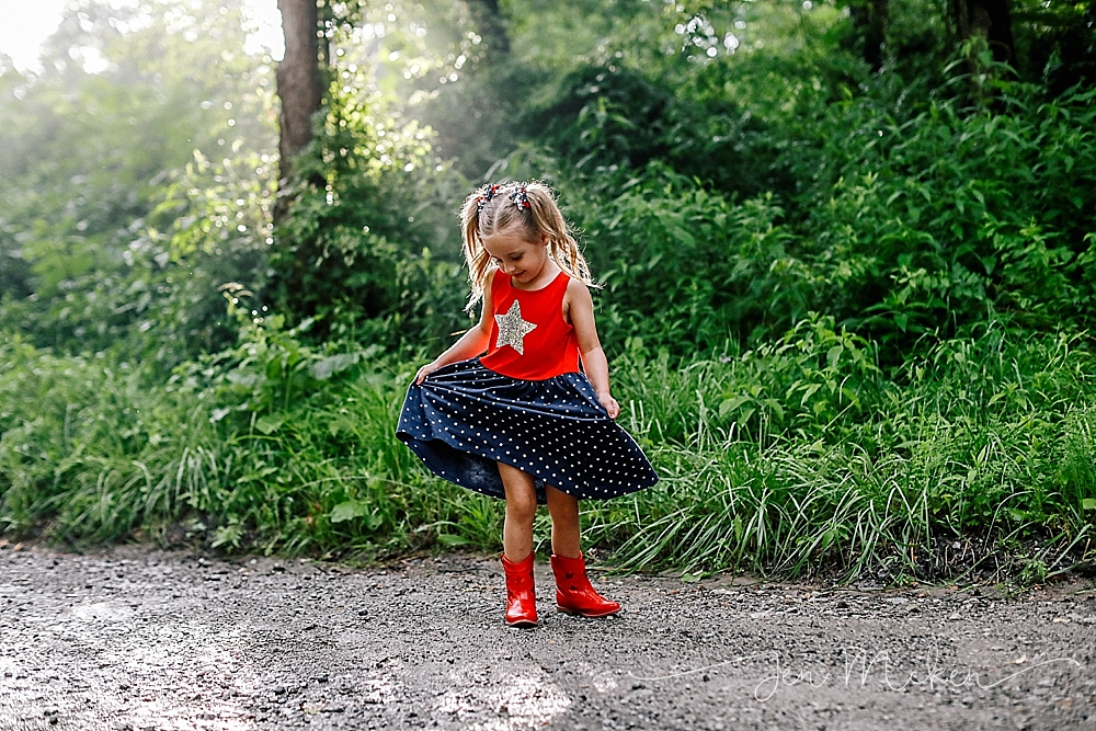 little girl twirls on the back road of a small town country road in blacklick pa