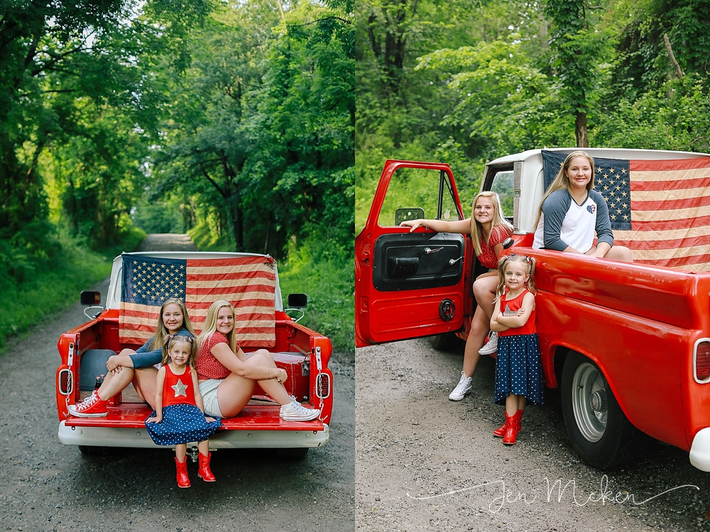 three sisters pose for a photo on the back of the 1968 chevy pickup on a dirt road