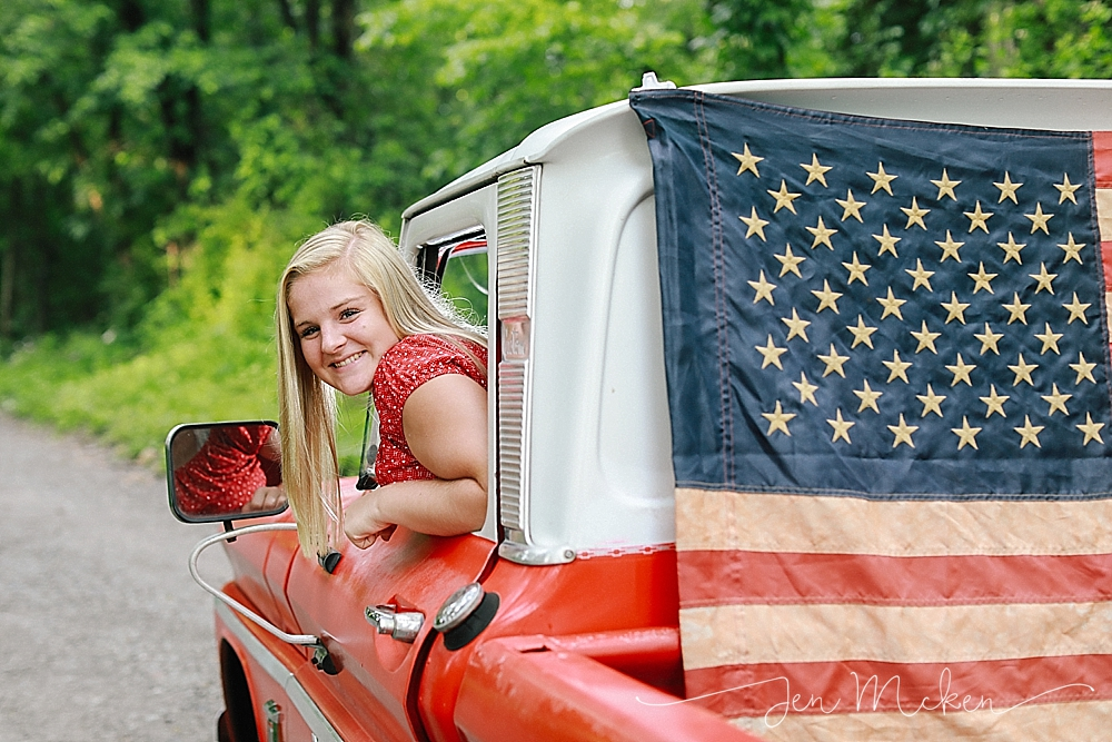 teen hangs out the window of a 1968 chevy pickup for a 4th of july mini session blairsville pa