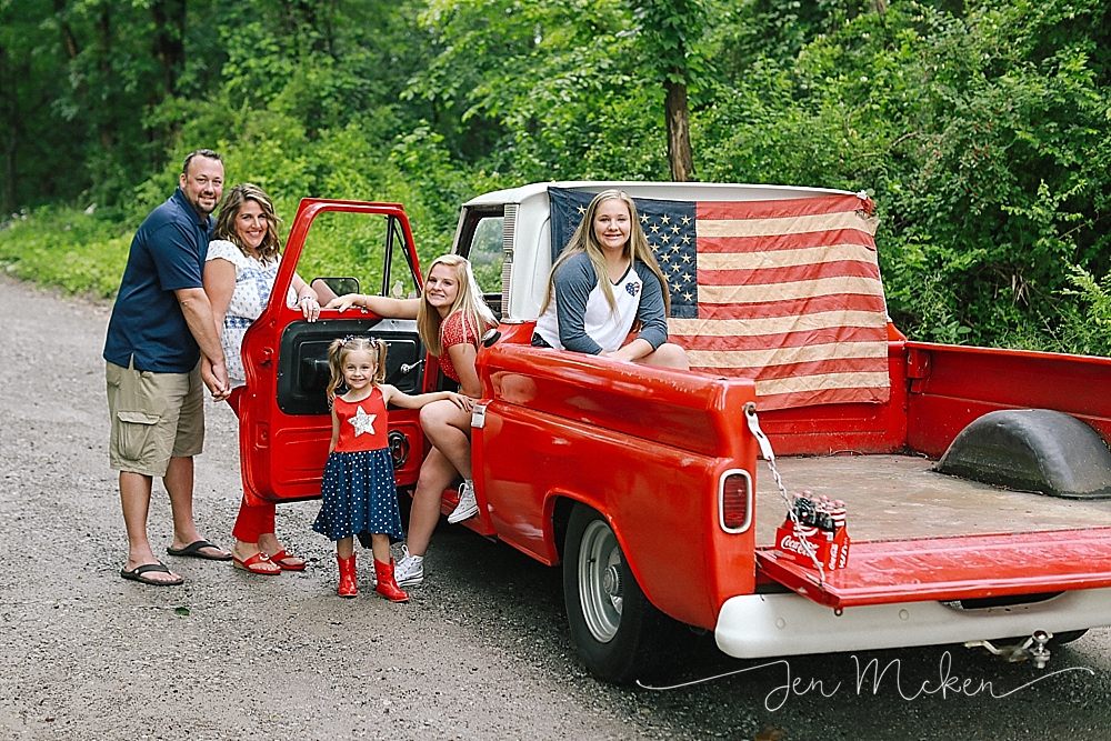 family with 1968 red chevy pickup on a small town dirt road in blacklick pa