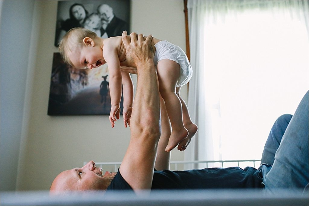 dad holding up 11 month old over his head