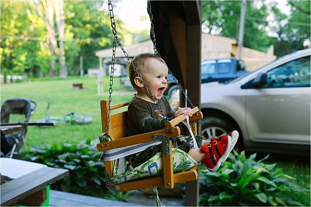 levi plays on grandmas antique swing at camp