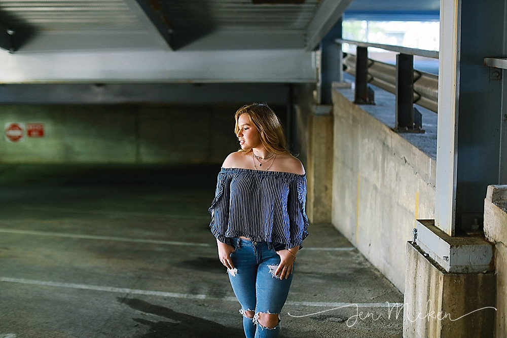 senior photos inside of a parking garage for an urban shoot in indiana pa