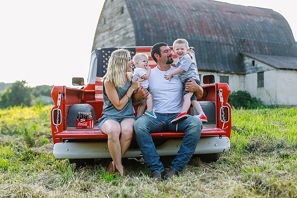 family photos on the bed of a red pickup truck in a field near a barn in blairsville pa