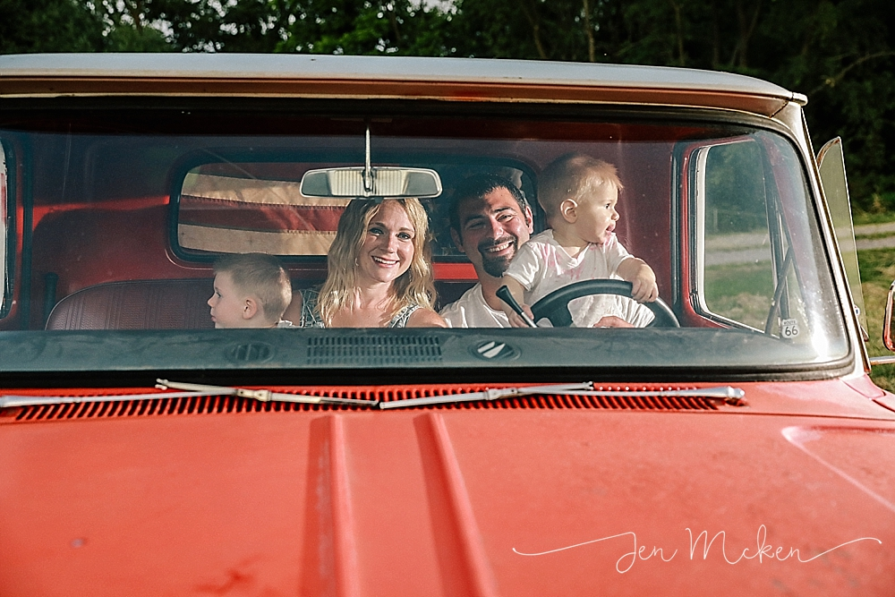 family pictures in the cab of a 1968 chevy pickup