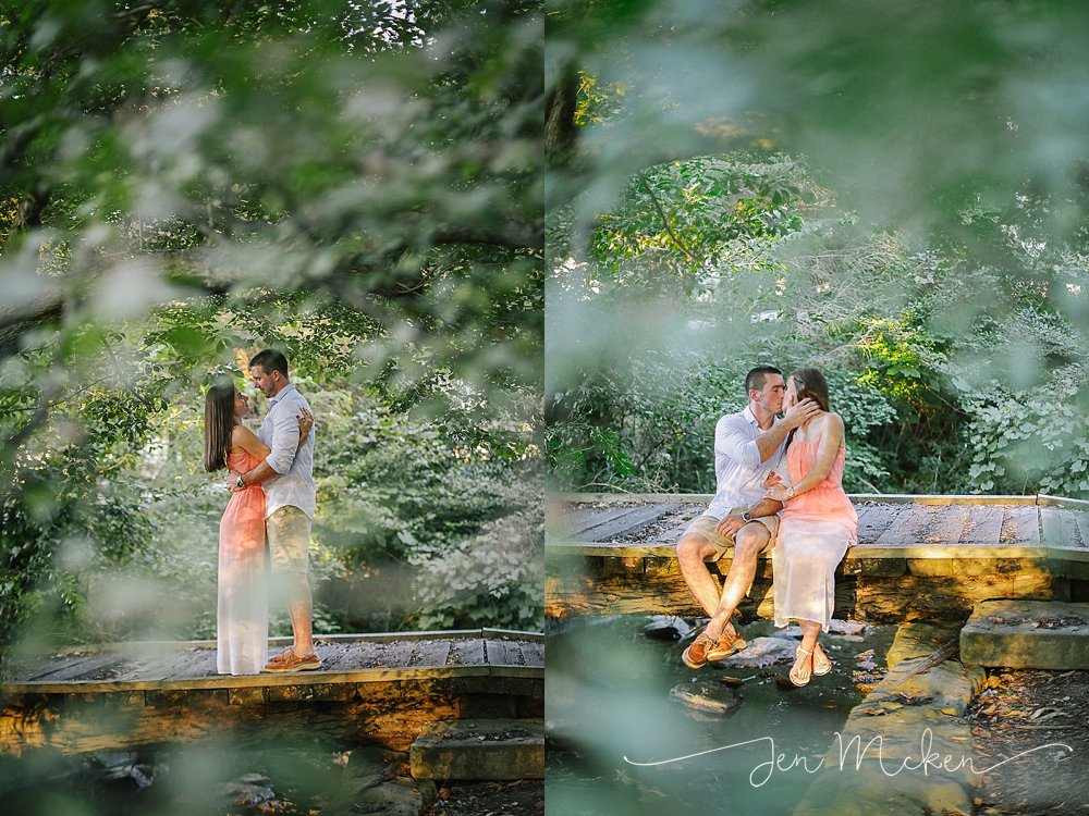 engagement photos on a wood bridge in a wooded area