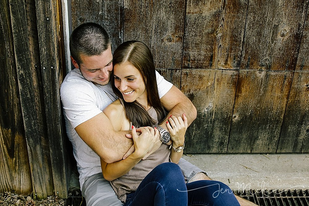 engagement photos near barn wood door in indiana county pa