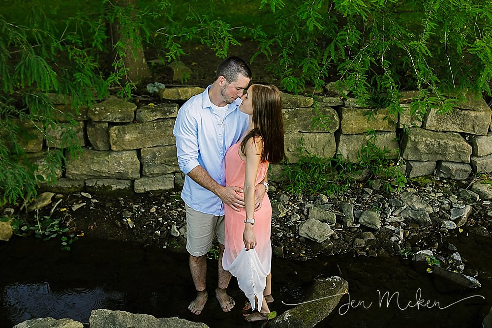 engaged girl and guy kissing in the creek in small town indiana pa