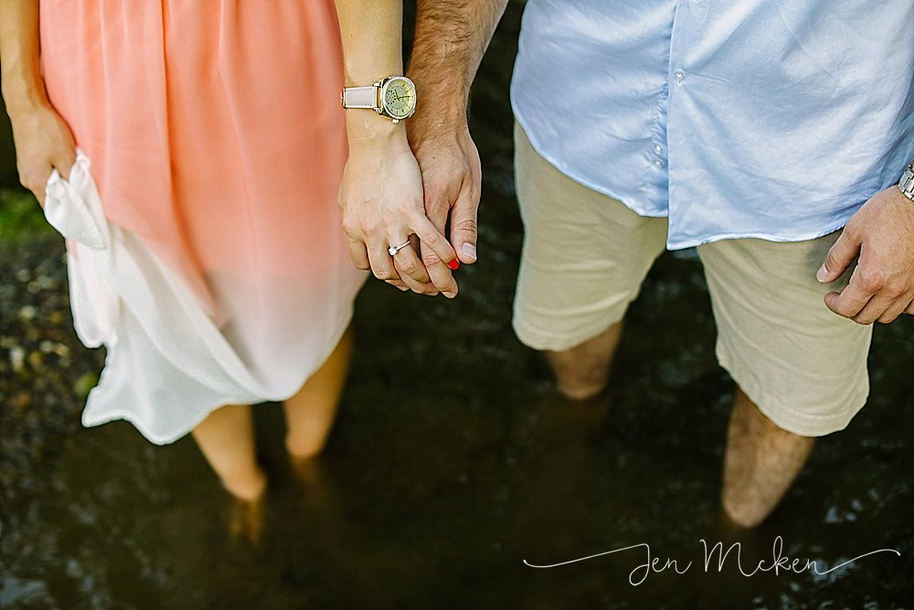 engaged couple holding hands in the creek in indiana county pa