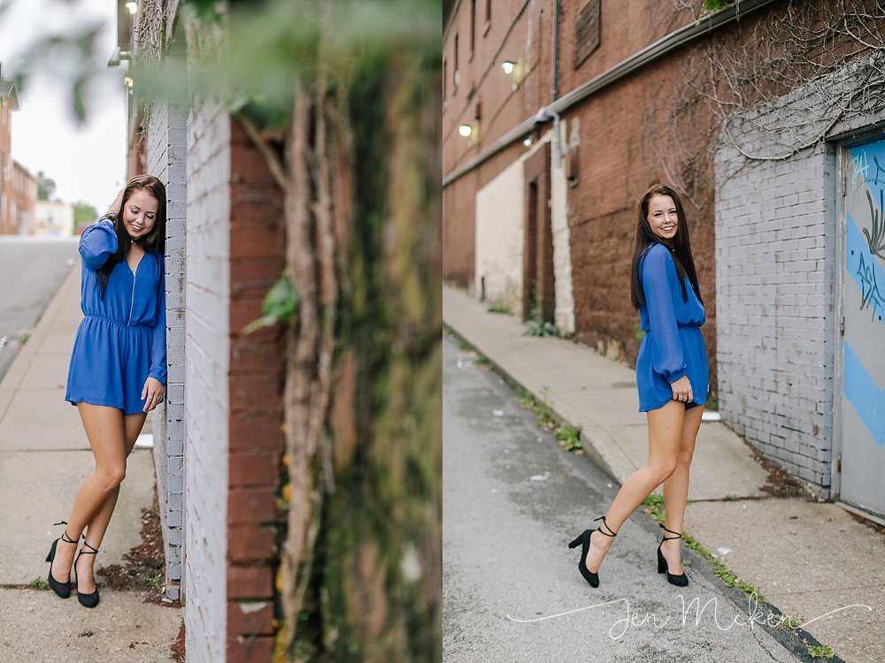 senior wearing a blue dress in an alley in indiana county pa