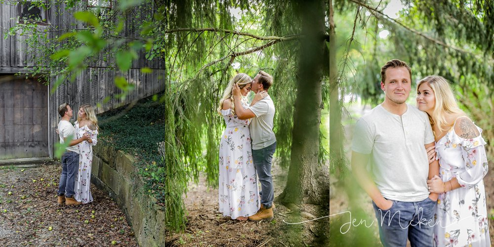 engagement photos in the woods surrounded by trees kissing in the forest