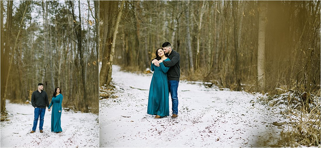 engaged couple embracing in the snow during winter