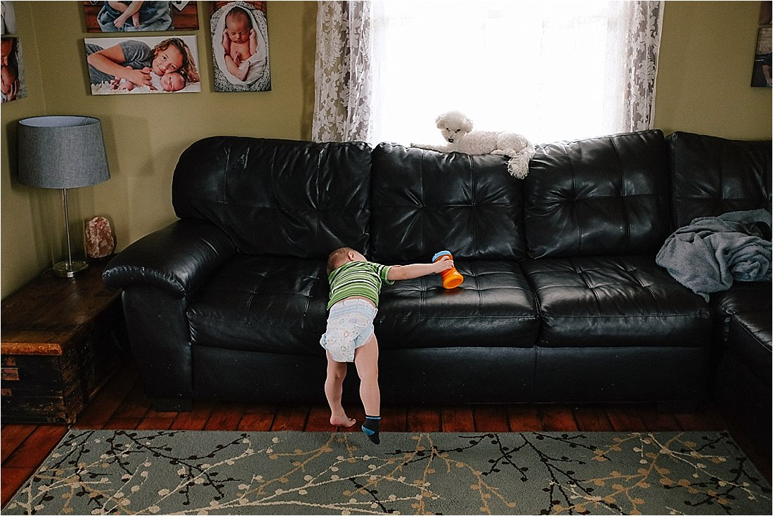 toddler climbing on couch