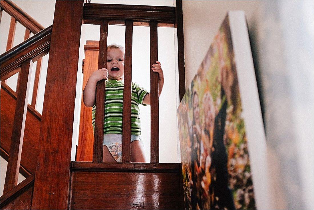 todder peeking thru banister