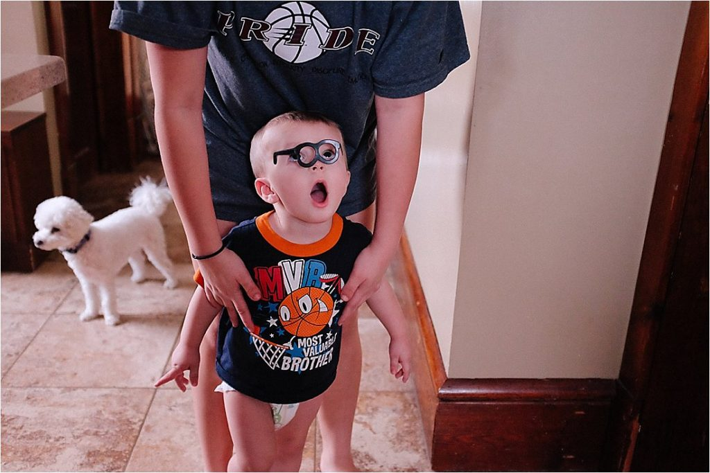 toddler with mr potato head glasses