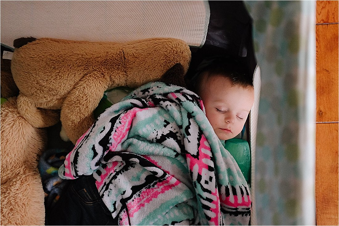 sleeping toddler with pink blanket