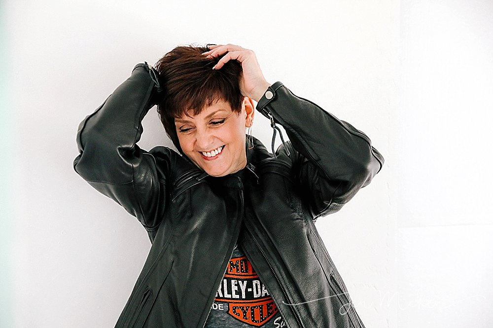 women over 50 wearing leather jacket in the studio with white background