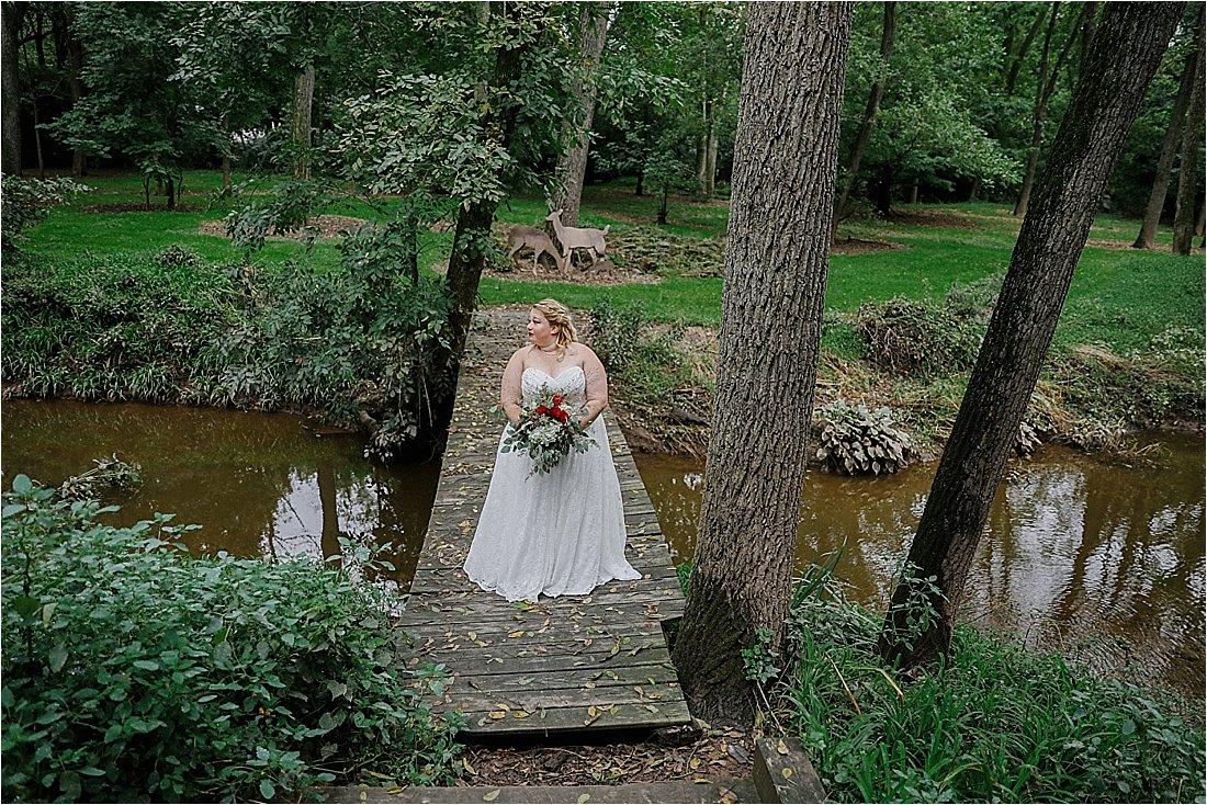 bride on a bridge near muddy water