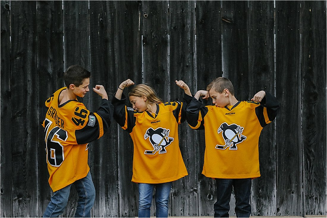 fall family photo with pittsburgh penquin jerseya