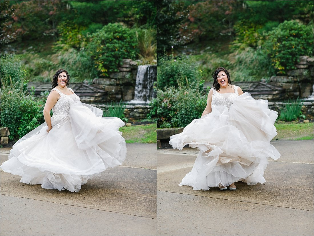 bride twirling her dress in front of a waterfall at oak lodge pa