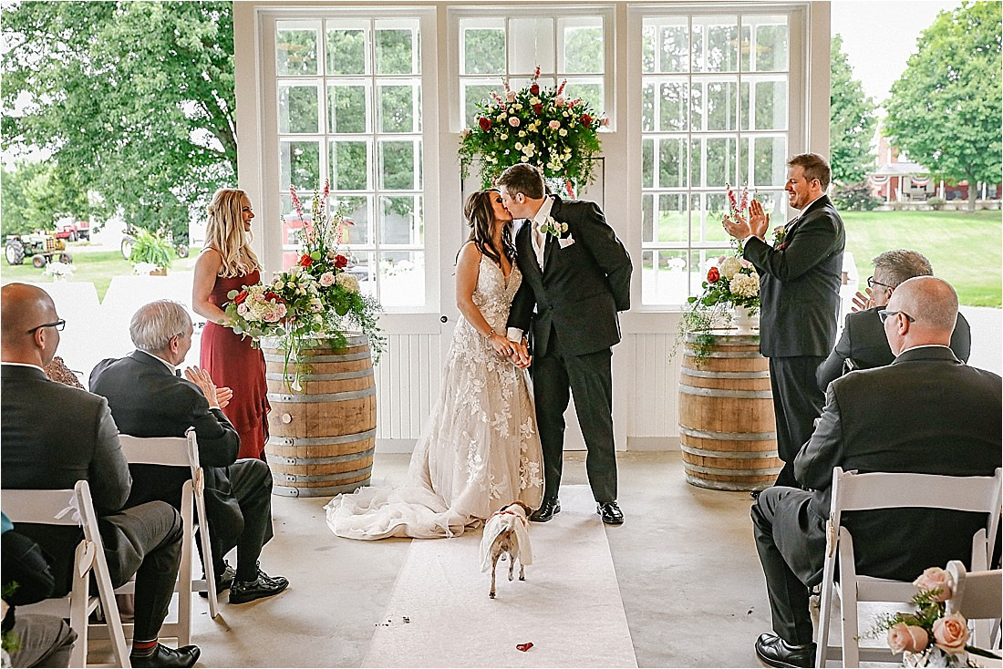 home farm barn wedding ceremony with a dog