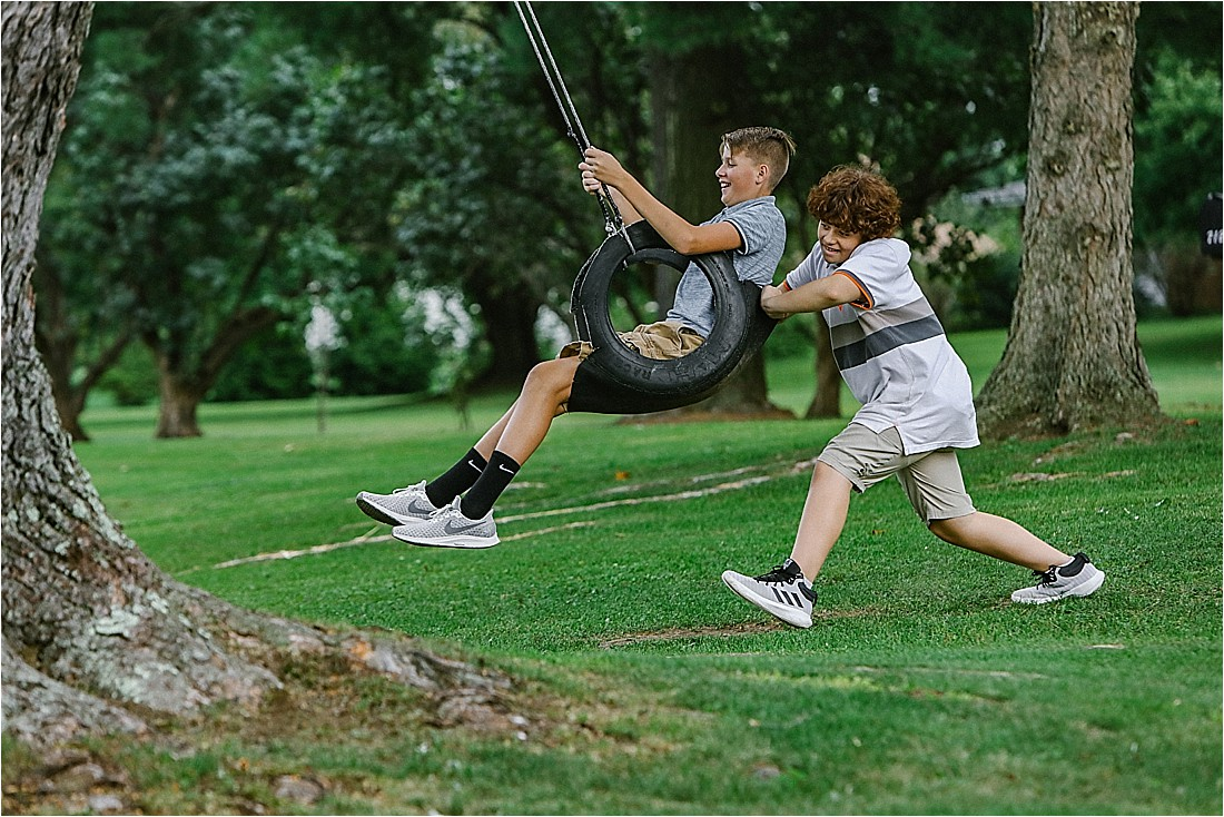 boys on a tire swing